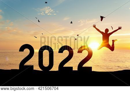 Silhouette Man Jumping And Birds Flying On Sunset Sky Tropical Sunset Beach And Number Like 2022 Abs