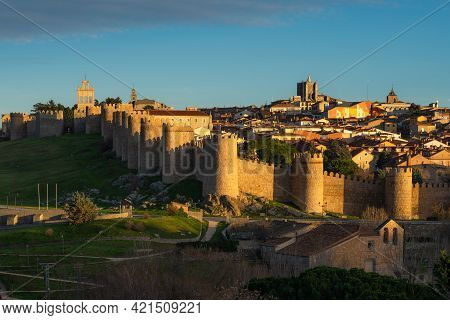Walls Of The City Of Avila (world Heritage Site By Unesco) And Cuatro Postes Lookout Monument At Sun