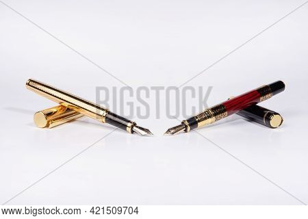 Fountain Pen, Two Beautiful Fountain Pens On White Background, Selective Focus.