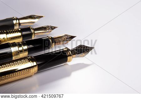 Fountain Pen, Four Beautiful Fountain Pens In Detail On White Background, Selective Focus.
