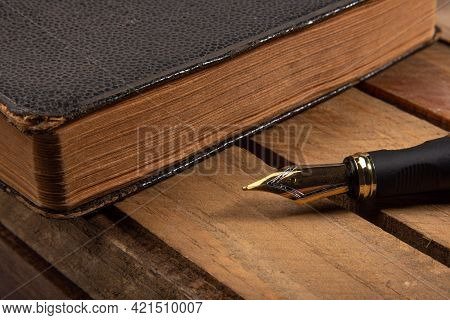 Fountain Pen, Beautiful Fountain Pen In Detail On Rustic Wood And An Old Book, Selective Focus.