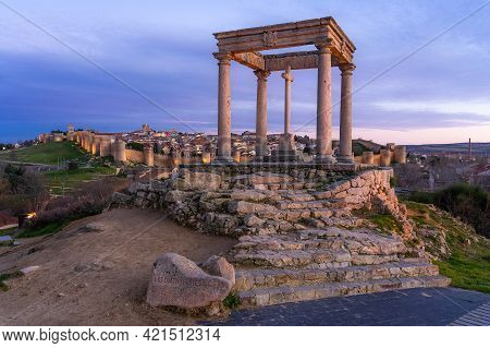 Walls Of The City Of Avila (world Heritage Site By Unesco) And Cuatro Postes Lookout Monument Illumi