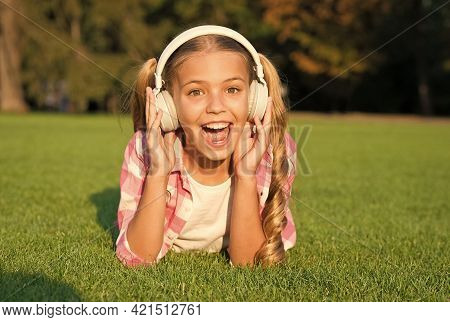 Small Girl Listen Audio Book. New Technology For Kids. Happy Childhood Memories. Listening To Music.