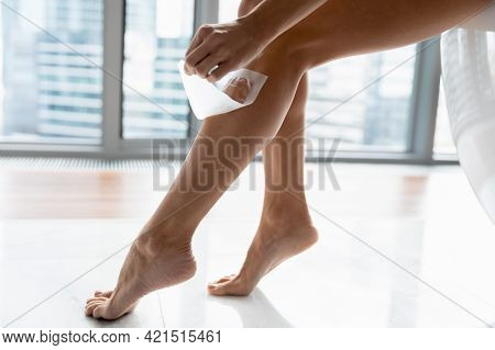 Slender Slim Young Woman Removing Hair From Ankles