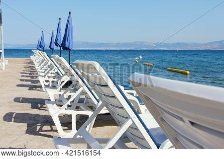 Rows Of Empty Chaise-lounges Over Sea Background, Supetar, Brac Island, Croatia