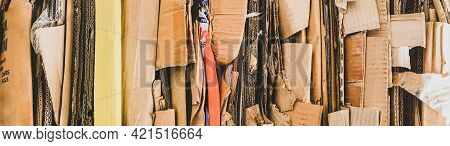 Banner With Bundle Of Colorful Wastepaper Cardboard To Be Recycled. Paper Cardboard Is Bundled Into