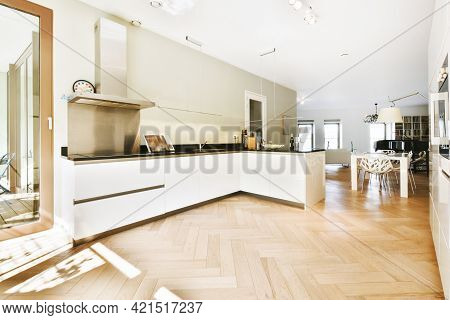 Modern Open Plan Kitchen Design With White Glossy Cabinets And Contemporary Appliances In Apartment