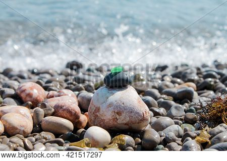 The Pyramid Is Built On A Pebble Beach Of Sea Pebbles With A Matte Smooth Green Glass At The Top. Ag
