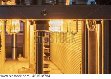 The Preform Shape Of Pet Bottle In The Blowing Mold Machine. The Operation Of Pet Bottle Processing