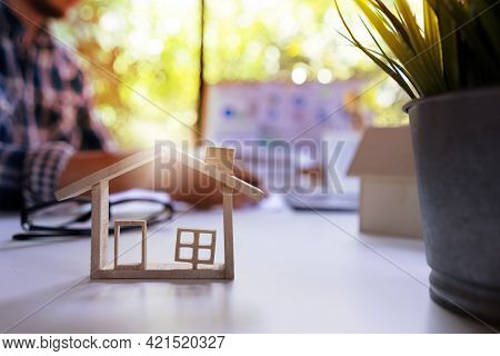 House Home Mortgage And Real Estate Business Concept. Background Of Real Estate Agent Working About