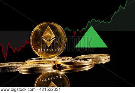 Golden Coins With Ether Logo Rise In Bull Market. New Cryptocurrency Ethereum Eth 2.0 Go Up In Tradi