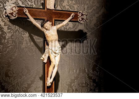 Turin, Italy - Circa May 2021: Old Crucifix Made Of Wood And Ivory (1750). Jesus Christ Symbol Of Re