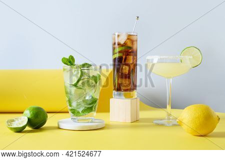 Classic Mojito, Cuba Libre, Margarita Cocktail With Lime And Lemon On Modern Color Yellow Background