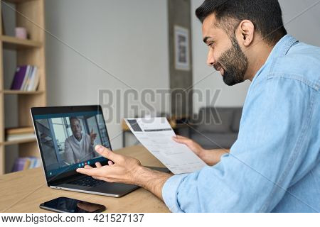 Young Indian Happy Smiling Businessman Holding Paper Cv Talking To Male Black Man Potential Employee