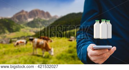 Intelligent Agriculture Concept With Milk Production Control On Smart Phone App. Farmer Analyze Prod
