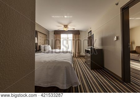 Columbus, Oh, 05-19-2021: A Family Suite Hotel Room With Two Queen Size Beds, Carpeted Floors And A