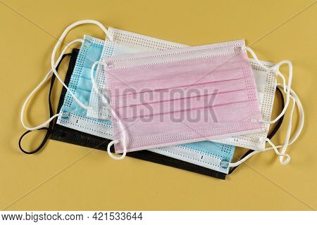 Multicoloured Disposable Face Masks Stack For Protection Against Respiratory Viruses