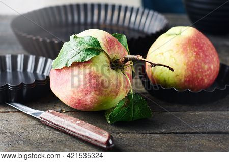 Fresh Red Apple On A Wooden Kitchen Table.