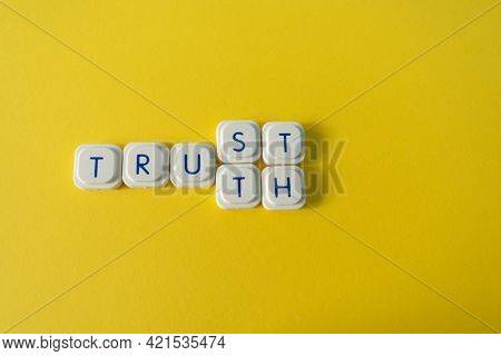 Trust Or Truth Message, Made With Letter Game Blocks In A Yellow Background. Confidence In Media Con
