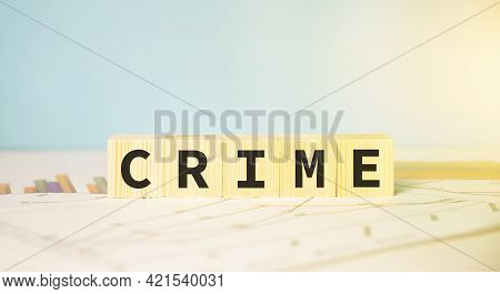Crime Word Written On Wood Block. Financial Fraud Concept.