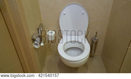 Interior Of The Room - Toilet In The Bathroom. Modern Interior Of Restroom With Ceramic Toilet Bowl.