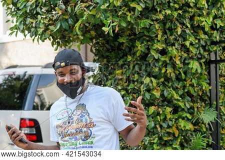 New Orleans, La - September 8, 2020: Young Man Wearing Face Mask Too Low Enjoys His Afternoon On Sep