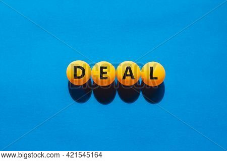 Business And Good Deal Symbol. Orange Table Tennis Balls With The Word 'deal'. Beautiful Blue Backgr
