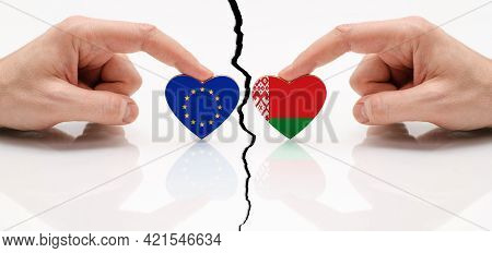 Concept Of Disagreement Between The Eu And Belarus. Flags Of The European Union And Belarus In The S