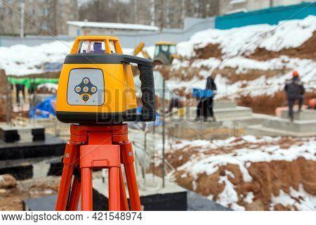 Laser Rangefinder At A Construction Site. Measuring Tool At A Construction Site. Accurate Constructi