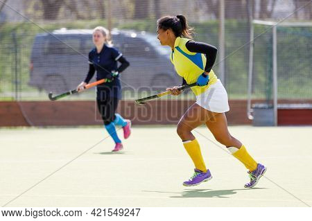 Young Field Hockey Female Player Runs With Stick