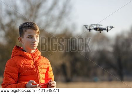 Teenage Boy Flying Small Drone In The Park