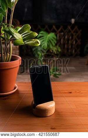 Black Smartphone With Blank Screen For Application Technology Mockup. Smartphone Stands In A Stand O