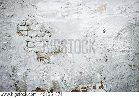 Old Brick And Plaster Wall Texture Background. Painted Distressed Wall Surface. Messy Building Facad