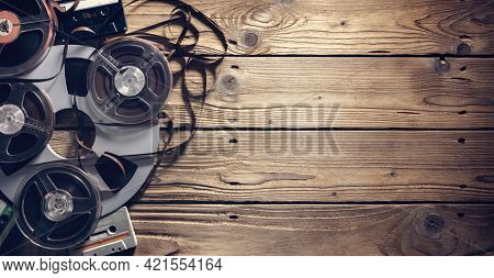 Retro audio reels and cassette tape music background with copyspace