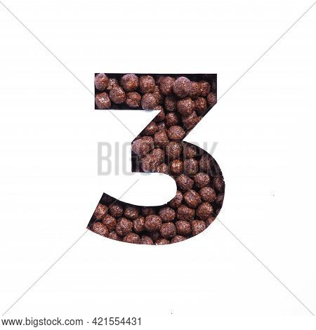 Number Three Of Nutritional Chocolate Cereal Balls, White Paper Cut In Shape Of Third Numeral. Typef