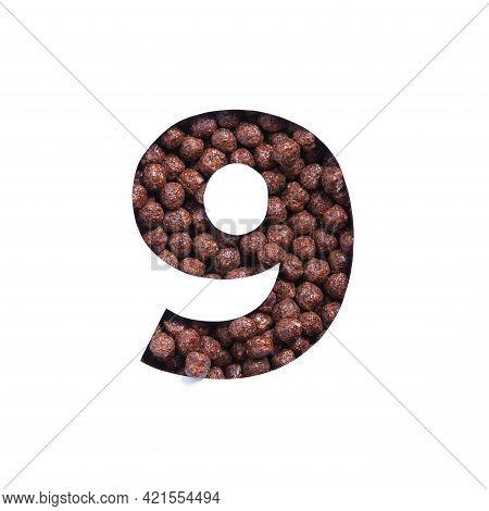 Number Nine Of Chocolate Cereal Balls, White Paper Cut In Shape Of Ninth Numeral. Typeface For Healt