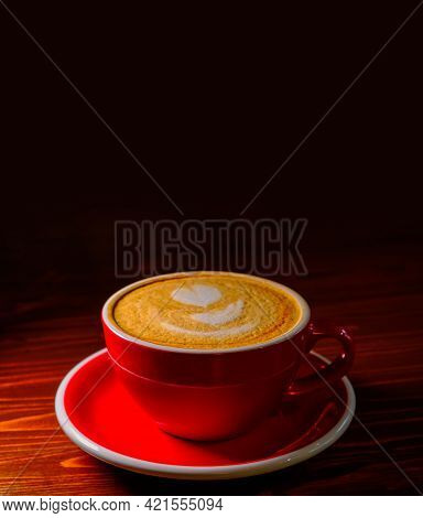 Coffee In Red Cuo On Table In Dark Lobby With A Lot Of Copyspace On Top
