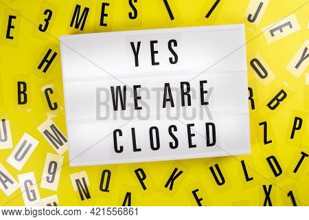 Lightbox With Text Yes. We Are Closed On Yellow Background With Black Letters Randomly Scattered. Co