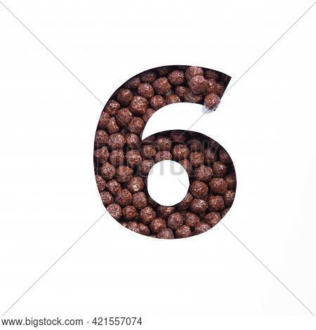 Number Six Of Chocolate Cereal Balls, White Paper Cut In Shape Of Sixth Numeral. Typeface For Health