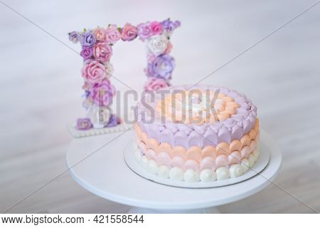 White Cake With Milk Cream Mousse And Raspberry Filling On A Round White Glass Plate. Cake With Whit