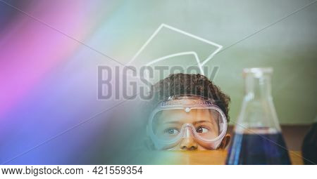 Composition of schoolboy with protective glasses in school laboratory with pink motion blur. science, learning and knowledge concept digitally generated image.