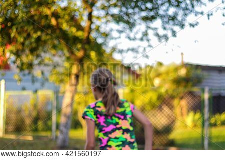 Defocus Abstract Bright Yellow Colorful Sport Background. Person Back. Skate Penny Board. Girl Runni