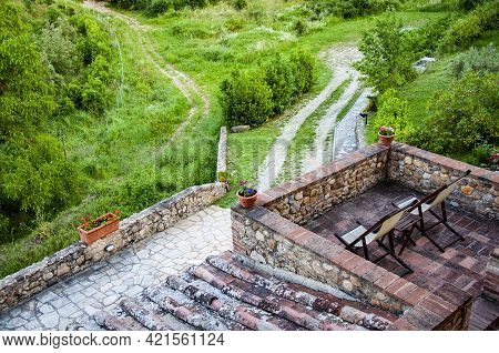 Panoramic View From The Tuscan Medieval House Surrounded By Blooming Nature, Italy