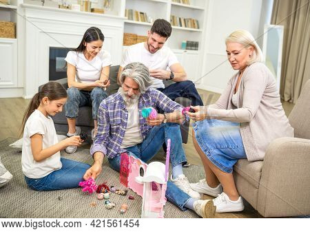 Big Happy Multigenerational Family Father Mother And Grandparents Playing With Cute Little Girl Gran