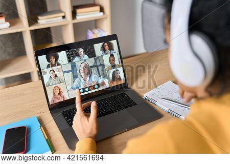 Over Shoulder View Of Adult Student Having Virtual Education Class Meeting With Diverse People Onlin