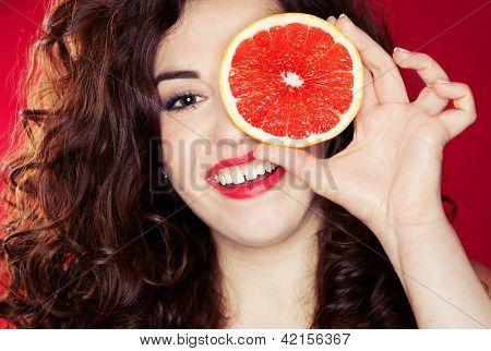 Portrait of pretty woman holding grapefruit