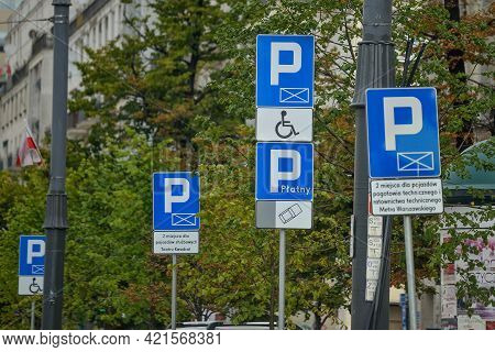 Warsaw. Poland - August 2015: Road Parking Signs, Parking For Cars, Parking For Disabled People. Aga