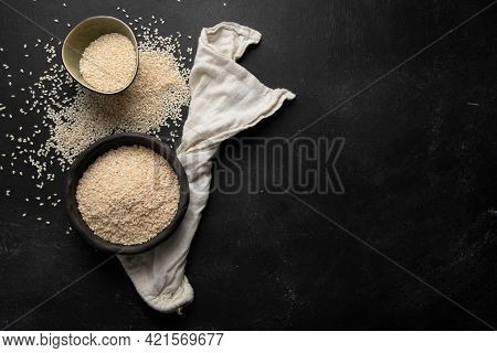 Black And White Sesame Seed On Black Background. Organic Food Concept