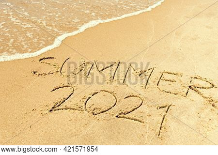 Summer 2021 Written On The Sand Of A Beach With Wave Washing, Erasing Or Canceling It During Coronav