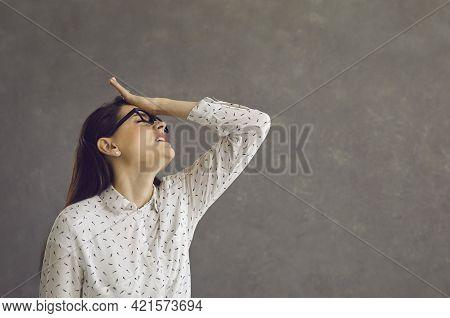 Young Caucasian Woman Touching Forehead Regrets Wrong Doing Studio Shot